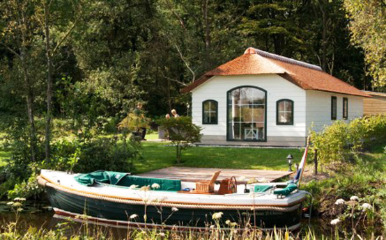Thatched Cottage vacation homes with boat at the Eysinga Holiday Estate